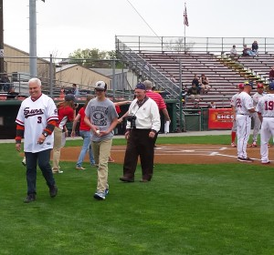 "Dane Anthony (far left) and his ""relief pitcher,"" Chase Geyer walk off the field at Hagerstown's Municipal Stadium after the ceremonial first pitch."