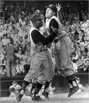 Hal Smith (right) is greeted at home plate by Roberto Clemente (left) and Dick Groat.