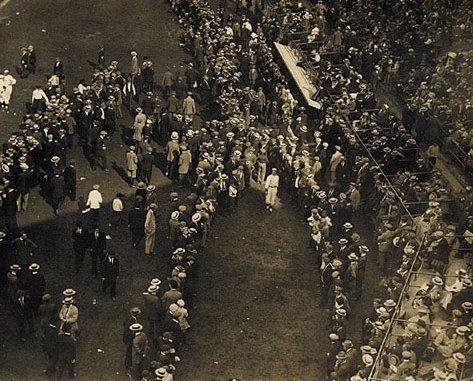Joe Wood warms up among a crowd of spectators.