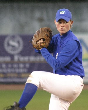 Robin Wallace, who played for the North American Women's Baseball League and eventually became its executive director, here shows her powerful pitching form. Robin is now an attorney.  Photo used by permission of Robin Wallace.