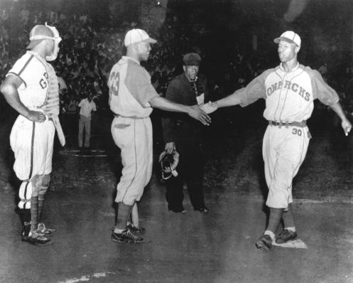 Willard Brown is greeted by Joe Greene after homering in game 3 of the 1942 Negro League World Series. Josh Gibson and umpire Fred McCreary look on.